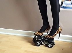 Toy buggy crushed beneath high heels