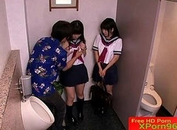 Petite Japanese schoolgirls cherish 3some